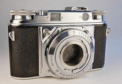 Voigtlander PROMINENT 35mm camera body only. Jammed shutter. Repair or parts