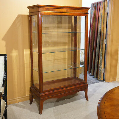Mahogany showcase with Glass doors and sides and back and Glass shelves