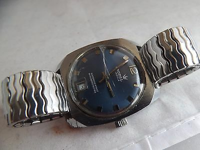 a vintage stainless steel cased blue dial cronel gents watch