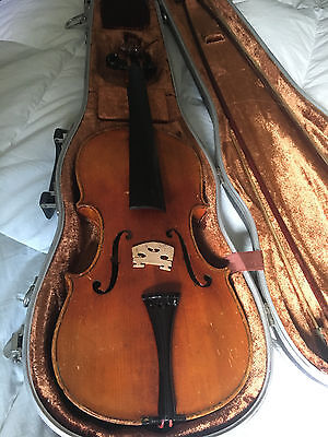 ANTIQUE VIOLIN (Stradivarious Copy)with bows, chin rest, and case included.