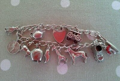 Solid 925 silver charm bracelet with 11 charms early 1970's