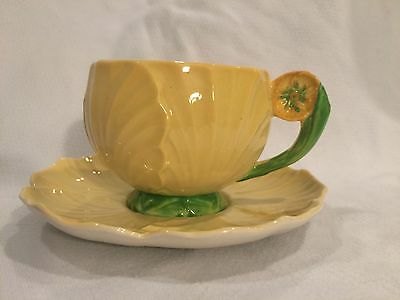 Carlton Ware Yellow Cup and Saucer with Flower Handle