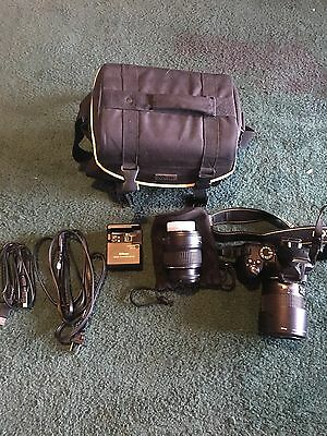Nikon D3000 Camera With Case Charger Cord, USB Cord Extra Lens And Quick Charger