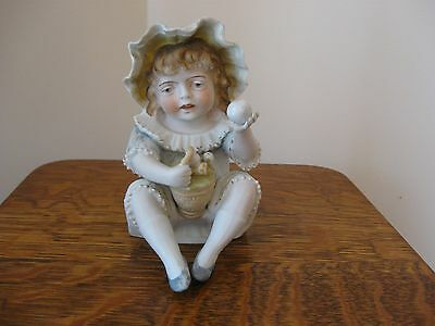 Collectible  Bisque Girl Piano Baby