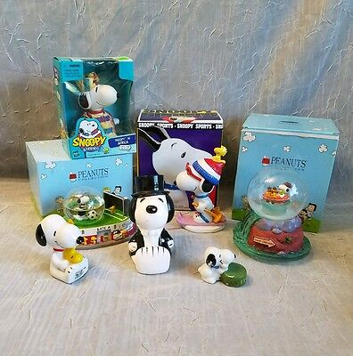 Lot Of 7 Snoopy Water Globes Paper Weights Ceramic Figurine & Piggy Bank