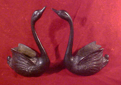 Pair of Black Metal Swans