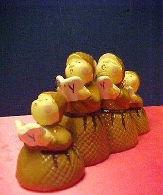Department 56 Four Singing Monks in a row