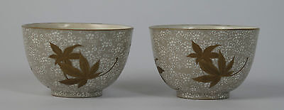 Pair of Japanese Banko ware pottery tea bowls