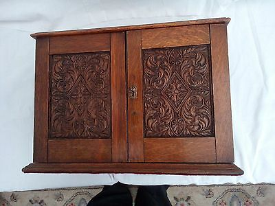 oak antique smokers cabinet with key