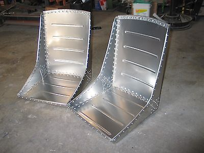A beautiful pair (2) of WWII style aircraft bomber seats, Over 150 Solid Rivets!