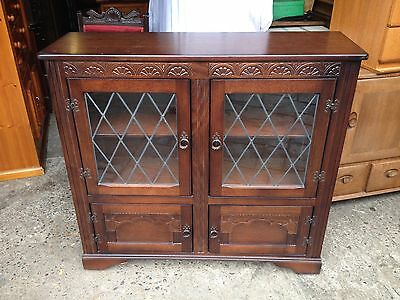 Dark Solid Oak Bookcase / Display Cabinet with Leaded Glass Doors