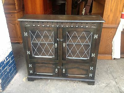Dark Solid Oak Bookcase / Display Cabinet with Leaded Glass Doors at Top