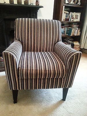 Upholstered  armchair, immaculate condition , sprung seat for extra comfort.