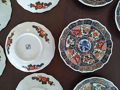 9 x Imari Plate 5 inch with floral elements and scalloped edges.