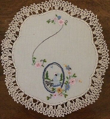Doily featuring a lady walking her dog, with lovely embroidered flowers