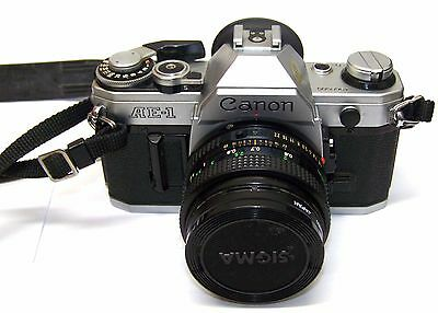 Canon AE-1 35mm SLR Film Camera with HOYA 50 mm Lens Flash Profoto Bag CLEAN