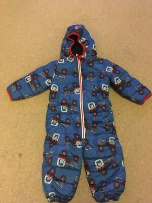 Suitable for boys or girls, the snowsuit has a darling dog and bone print, plus ears on the hood that make it worthy of a baby photo shoot. Has an opening for a carseat strap Mittens snap into place.