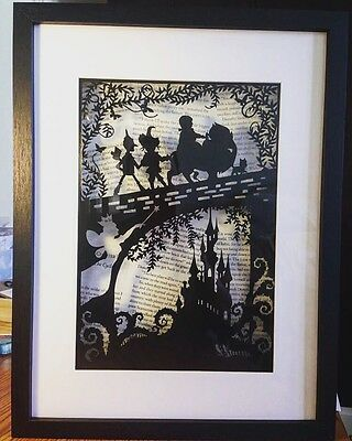 Wizard Of Oz Paper Cut. Hand Cut To Order. Framed Over Book pages,