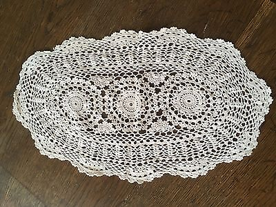 Four hand crocheted doilies.