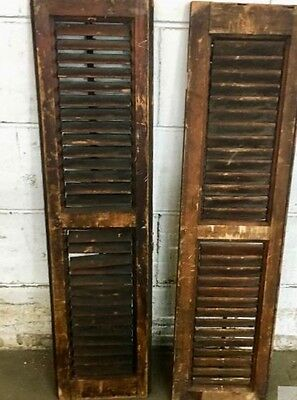 A pair of small, stained , vintage, wooden shutters
