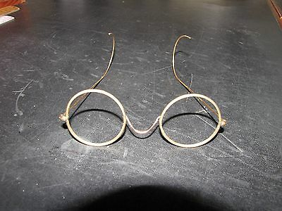 Vintage women's or child's gold coloured wire spectacles