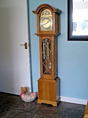 A lovely solid  golden  oak chiming  longcase clock. by Smallcombe of Essex.