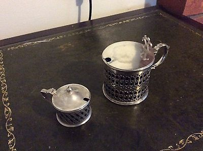 Silver plated mustard and sauce pots with bristol blue glass liner