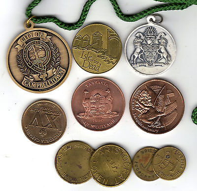 Group of interesting medallions and checks