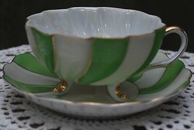 Footed green and white teacup and saucer Made In Japan