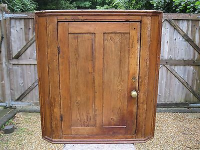 VERY OLD CORNER CUPBOARD. Delivery poss. Also pine dresser, chest, table & pews
