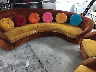 Velvet Curved Sofa with two chairs.