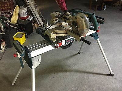 Compound saw with stand and vacume model LS0714, sells for $900 with stand only