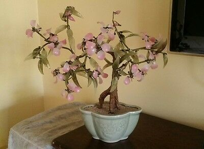 beautiful chinese glass made blossom plant
