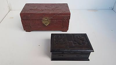 2 carved wooden boxes