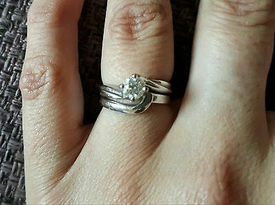 white gold 18ct engagement ring (£1650) and wedding band (£400) size J