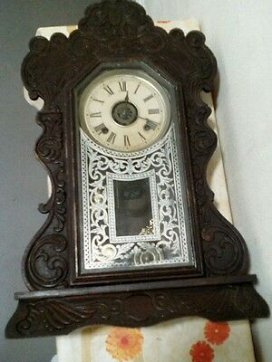 Ansonia Clock Co. antique wood case wall clock; made in USA