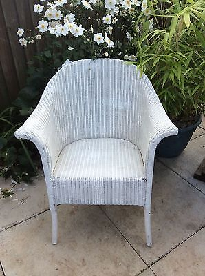 Vintage Lloyd loom style wicker chair. Sturdy and sound. White