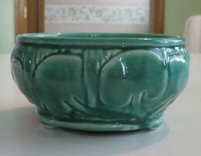 vintage green ceramic bowl with decorative sides
