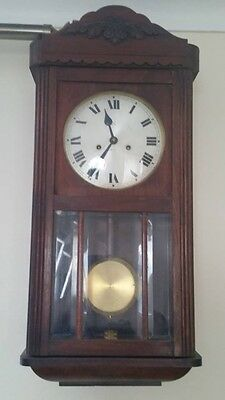 Antique wall clock with Chimes on half hour and hour & key lovely condition