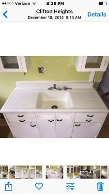 Vintage Antique White Enamel Cast Iron Kitchen Sink with metal cabinet