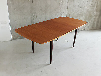1970's mid century modern long English teak extendable table with tapered legs