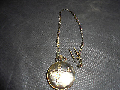 Vintage Golfers/bronze effect Omega pocket watch and chain.