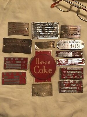 14 Old aluminum And Brass Coca-Cola Vending Machine Tags And Plates.