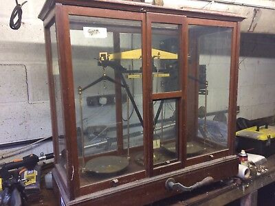 Large Vintage scales in glass cabinet by L. Oertling.