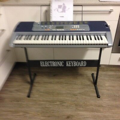 CASIO KEYBOARD, LK110, with full Lighting system keys, including stand & more