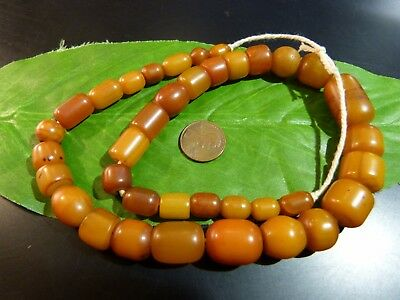 ANTIQUE BUTTERSCOTCH AFRICAN AMBER RESIN BEAD 18 1/2 INCH STRAND patina