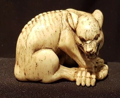 a Stunning 18th C Edo period Netsuke of a Wolf with a crab. Kyoto School. Signed