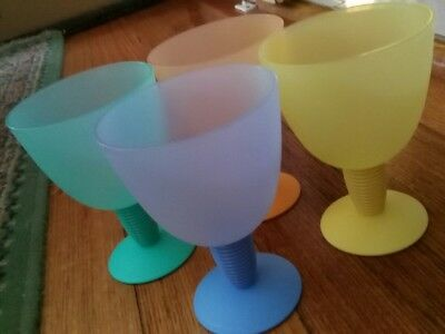 4 Tupperware Wine Glasses.