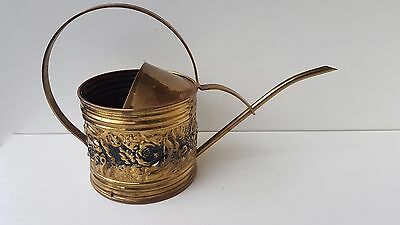 ornate watering can