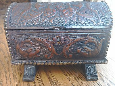 Antique leather clad embossed decoration very rare.